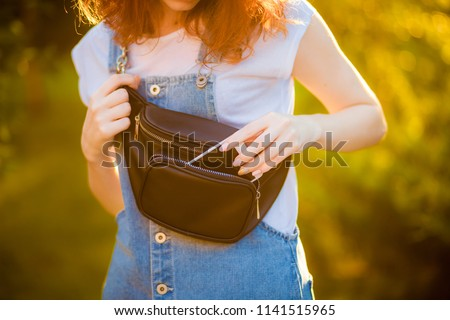 Red-haired girl with waist bag  #1141515965