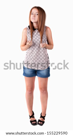 Stock Photo Red-haired teen girl in shorts. isolated on white background