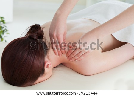 Red-haired woman having a rolling massage - stock photo
