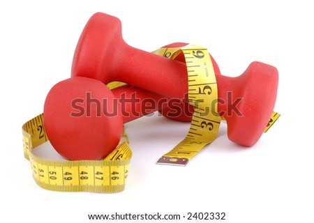 Red hand weights with tape measure on a white background.