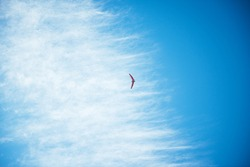red hang glider against blue sky
