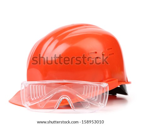Red hard hat and glasses. Isolated on a white background.
