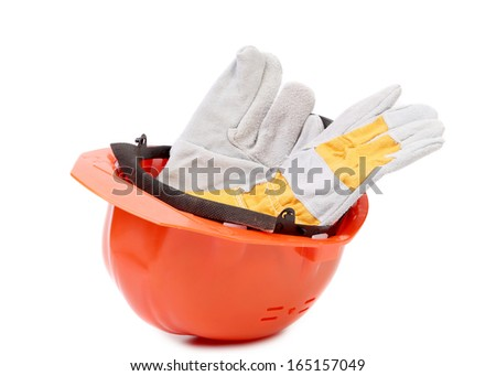 Red hard hat with leather gloves. Isolated on a white background.