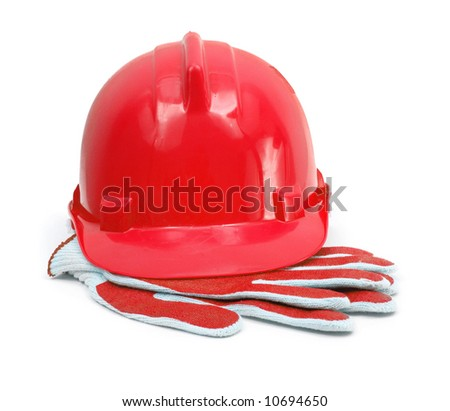 red hardhat and working gloves isolated on white background