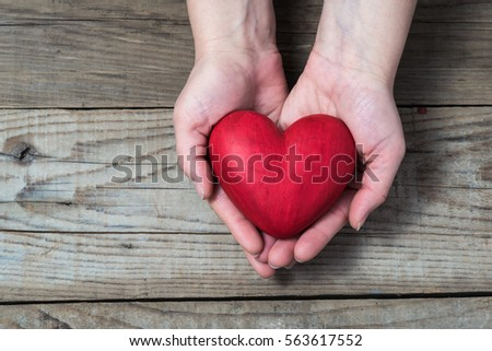 Red hart on palms - Love symbol #563617552
