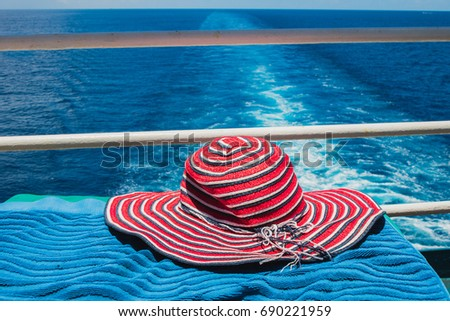 Red hat on cruise ship with blue ocean