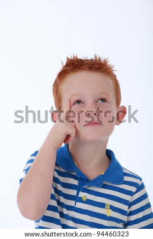 Red head boy wearing blue striped shirt with thinking expression on face