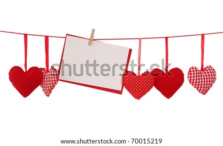 Red heart and blank card isolated on white background