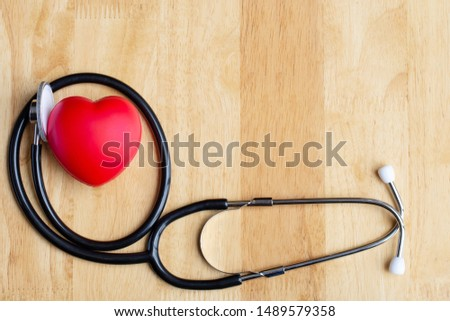 Red heart and  stethoscope on wooden table. Doctor tool for heartbeat listening. Healthcare concept. Empty place for text, #1489579358