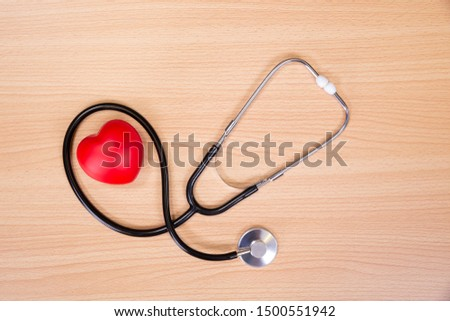 Red heart and stethoscope on wooden table. Doctor tool for heartbeat listening. Healthcare concept. Empty place for text, #1500551942