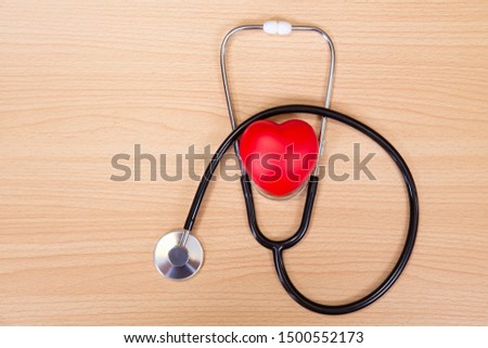Red heart and stethoscope on wooden table. Doctor tool for heartbeat listening. Healthcare concept. Empty place for text, #1500552173