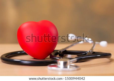Red heart and stethoscope on wooden table. Doctor tool for heartbeat listening. Healthcare concept. Empty place for text, #1500944042