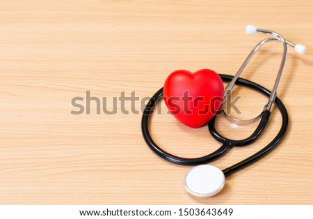 Red heart and stethoscope on wooden table. Doctor tool for heartbeat listening. Healthcare concept. Empty place for text, #1503643649