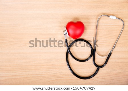Red heart and stethoscope on wooden table. Doctor tool for heartbeat listening. Healthcare concept. Empty place for text, #1504709429
