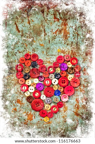 Red heart background on vintage old surface.Old colorful buttons/Valentines card
