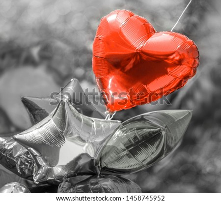 Red heart balloon on a black white background. Black and white photography. #1458745952