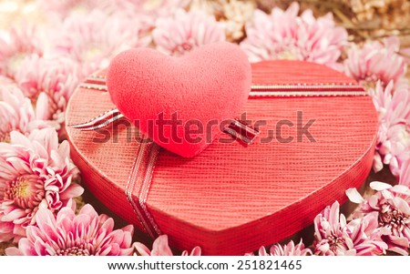 Red Heart Gift Box and flowers on Vintage retro background.(for Valentine day.)