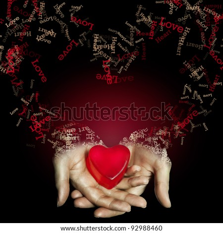 Red heart in hand on black background. love and heart. love concept.