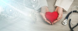 Red heart in hands of doctor; health insurance concept; panoramic banner