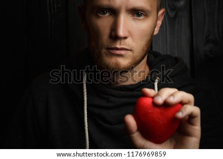 red heart in hands on a dark background, the concept of love and care for loved ones and needy #1176969859