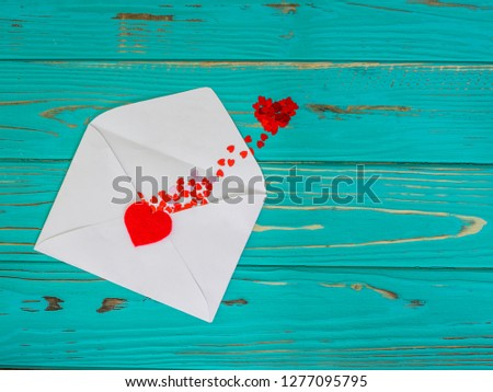 Red heart in love jumped out of envelope on valentines day #1277095795