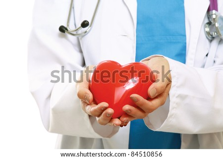 Red heart in nurse's hands isolated on white