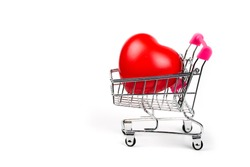 Red Heart in shopping cart or trolley Isolated On White Background.Blood pressure control-Health care concept.Valentine Concept.