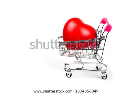 Photo of  Red Heart in shopping cart or trolley Isolated On White Background.Blood pressure control-Health care concept.Valentine Concept.