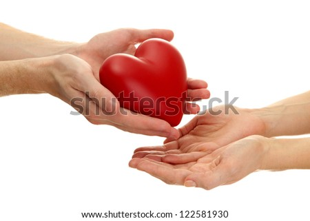 Red heart in woman and man hands, isolated on white