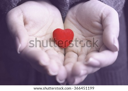 Red heart in woman hands #366451199