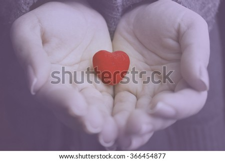 Red heart in woman hands #366454877
