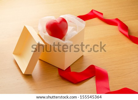 Red heart inside open gift box