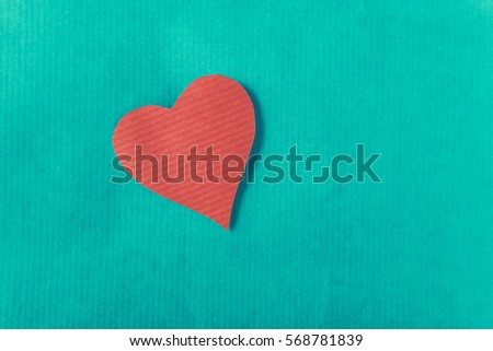 Red heart, isolated on green background #568781839