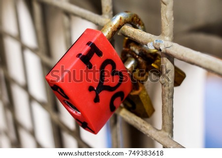 Red heart love lock on the bridge fence. Valentine background