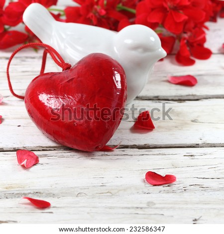 red heart love with bird lovers and flowers on wooden table