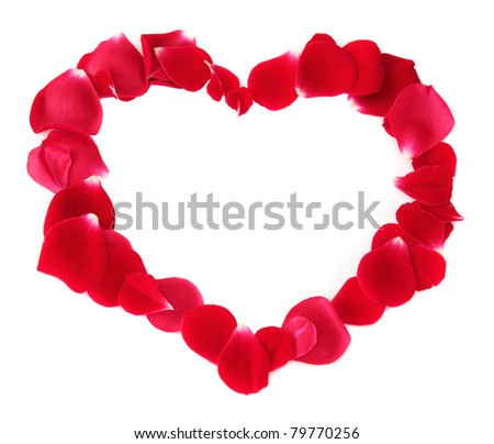Red heart made of rose petals isolated on a white background.