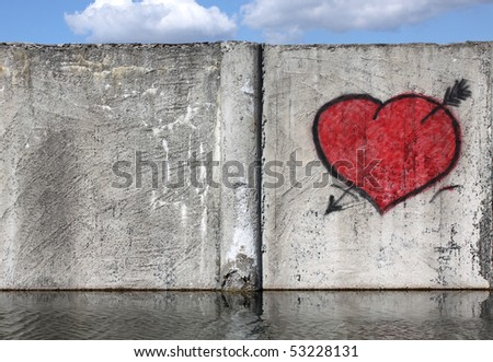 Red heart on a fence with place for text