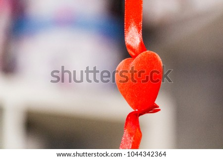 Red heart on a suspension bracket #1044342364
