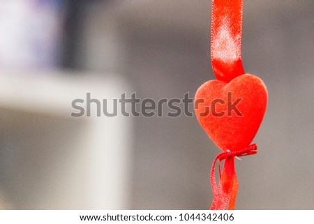 Red heart on a suspension bracket #1044342406