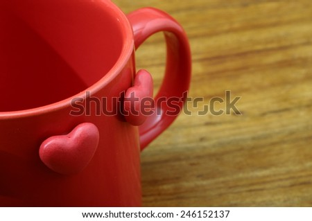 Red heart on coffee mug for love and valentine\'s day celebration