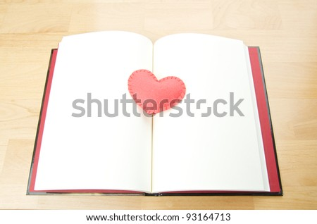 red heart on open notebook
