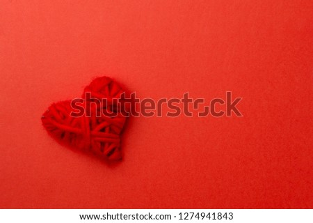 Red heart on red background. #1274941843