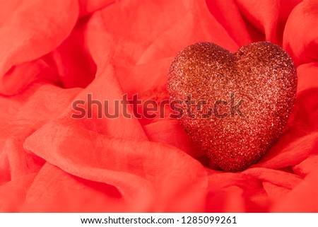 Red heart on red background #1285099261