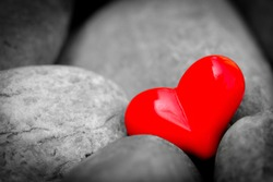 Red heart on Stones. Happy Valentine's Day concept.
