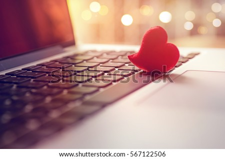 Red heart on the computer keyboard with sunlight and shadow. Internet dating, copyspace, Valentines day concept. #567122506