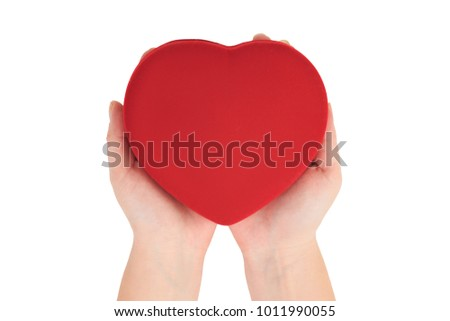 red heart on the palms, female hands holding bright red heart on white background top view. Love, marriage, engagement, Valentine's day concept #1011990055