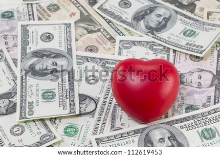 Red heart on US dollars background (Love for Money concept)