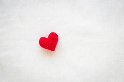 Red heart on white isolated background with copy space. Concept for love valentine, help, kindness, organ donate, donor, volunteer, heart health, mental healthcare, insurance and csr business plan.