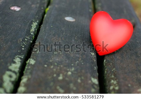 red heart on wood #533581279
