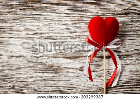 Red heart on wooden background. Valentines Day card